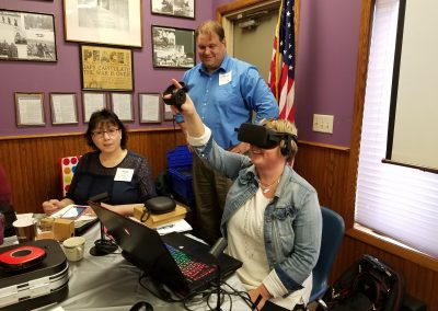 Table 3 Virtual Reality Brian Kopetsky gave Vicky Calmes and Amanda O'Neal a tour of VR.